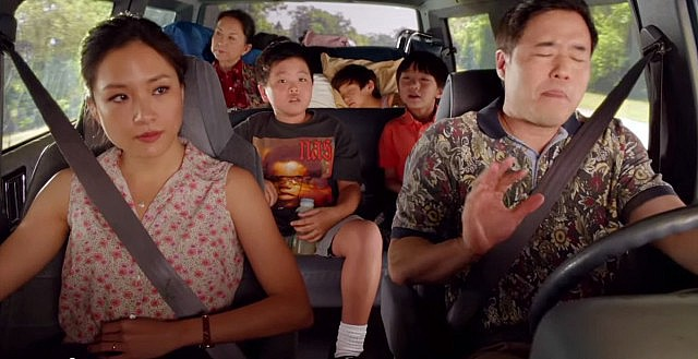 The Huang family in a car