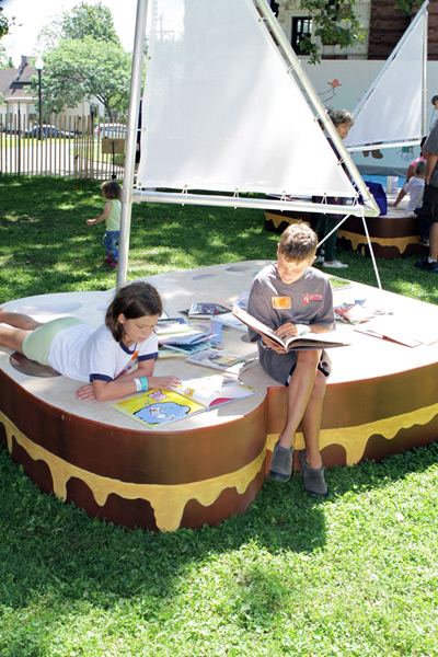 Children reading on a sandwich sailboat at Literary Lots in Cleveland