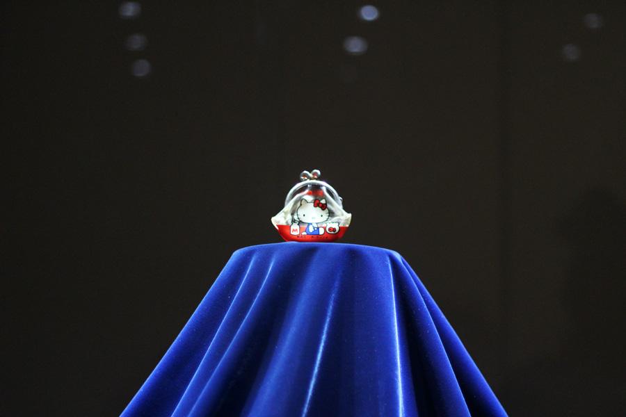 Hello Kitty purse set on a pedestal
