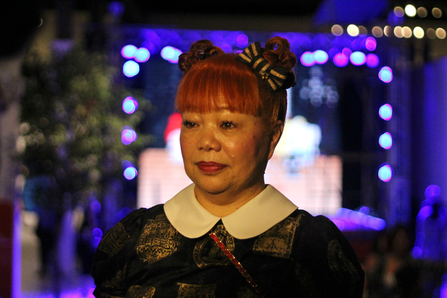 Older woman in Hello Kitty cosplay