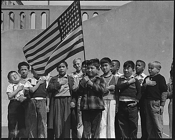 Children participate in the pledge of alliegance.
