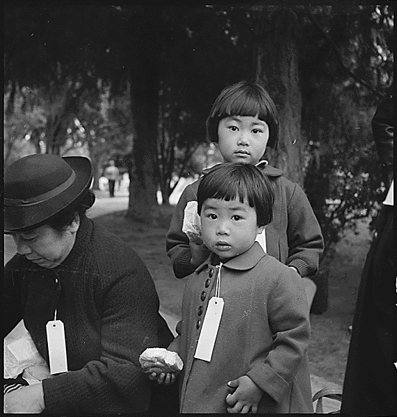 Mochida family children await a bus to an internment camp