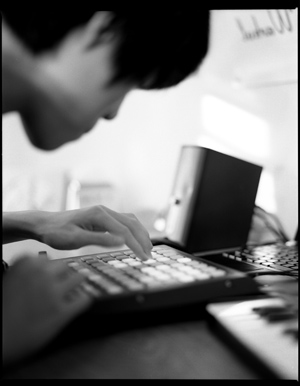 Sunik Kim creating music.